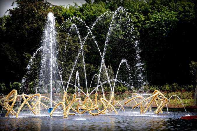 """""""Les Belles Danses"""" (The beautiful dances) by French artist Jean-Michel Othoniel, one of the three fountain sculptures installed at the Water Theatre Grove in Versailles outside Paris, France,  Tuesday, May 12, 2015. Designed by Andre Le Notre between 1671 and 1674, this grove is located in the gardens of the Palace of Versailles. Following an international competition aimed at garden designers for the restoration of the Water Theatre grove, the landscape designer Louis Benech and the artist Jean-Michel Othoniel were chosen for their contemporary art project. (AP Photo/Christophe Ena)"""